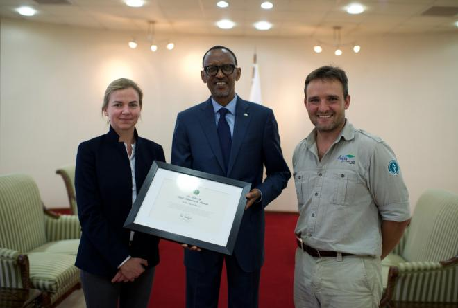 His Excellency President Paul Kagame of Rwanda holds a plaque commemorating the return of the rhino